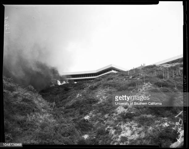 General view of fire and fire fighters, 3 December 1958. Corral Canyon;Malibu Colony;Ocean side of hiway 101;Lawrence Pittman -- 13 years;Greg...