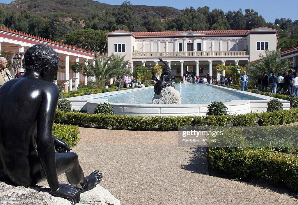 A Modern Replica Of The Bronze Statuary From The Villa Dei Papiri (L) Is