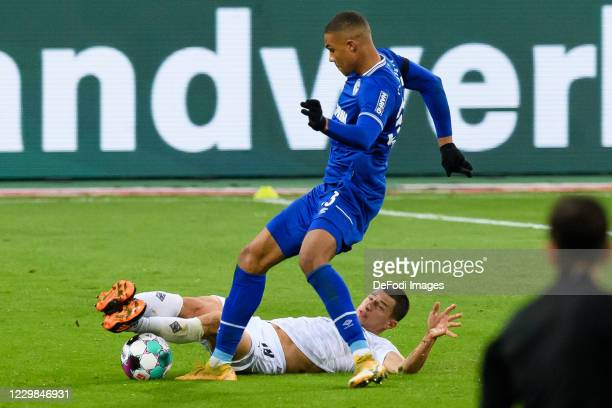 Malick Thiaw of FC Schalke 04 and Stefan Lainer of Borussia Moenchengladbach battle for the ball during the Bundesliga match between Borussia...