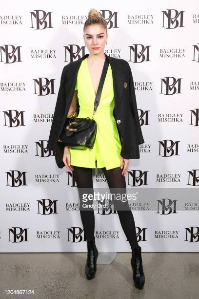 Malie Tremblay poses backstage for Badgley Mischka during New York Fashion Week: The Shows at Gallery I at Spring Studios on February 08, 2020 in New...