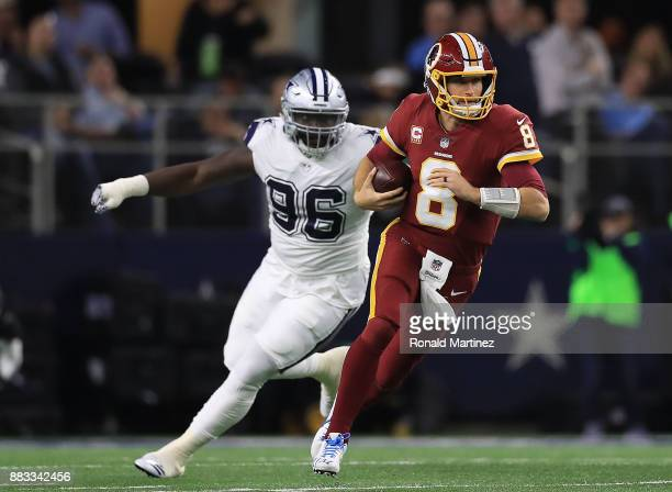 Maliek Collins of the Dallas Cowboys pursues a scrambling Kirk Cousins of the Washington Redskins in the first quarter of a football game at ATT...