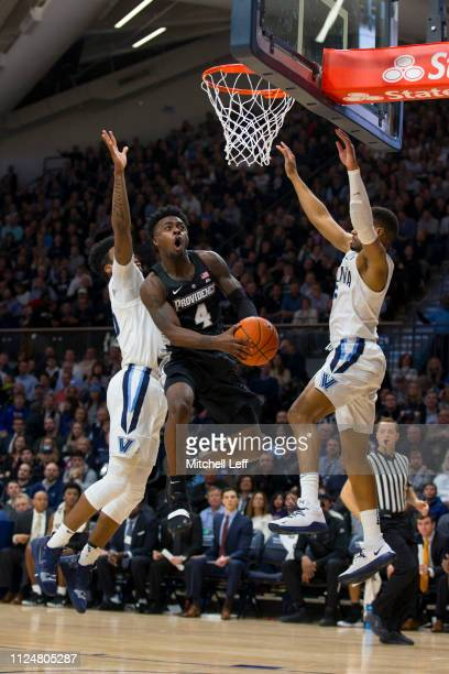 Maliek White of the Providence Friars attempts a shot against Saddiq Bey and Phil Booth of the Villanova Wildcats in the second half at Finneran...