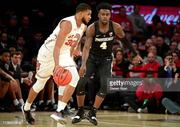 Maliek White of the Providence Friars defends LJ Figueroa of the St John's Red Storm at Madison Square Garden on February 09 2019 in New York City