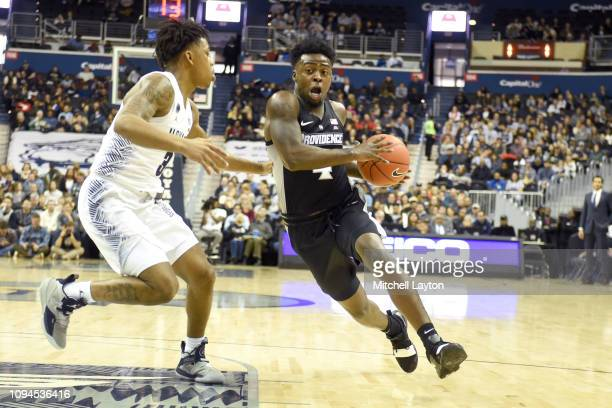 Maliek White of the Providence Friars dribbles by James Akinjo of the Georgetown Hoyas during a college basketball game at the Capital One Arena on...