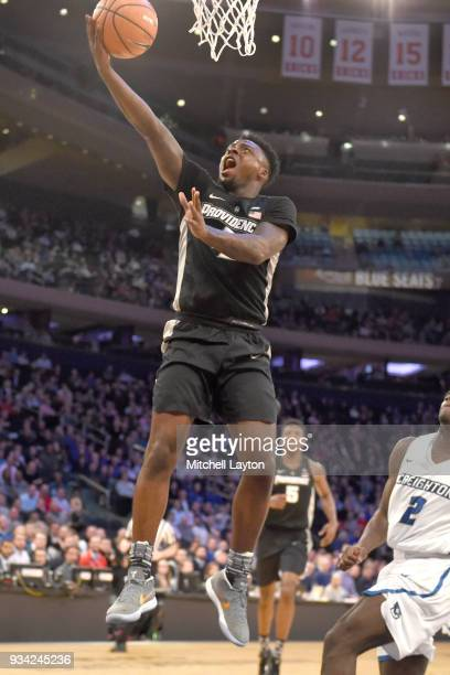 Maliek White of the Providence Friars drives to the basket during the quarterfinal round the Big East Men's Basketball Tournament against the...