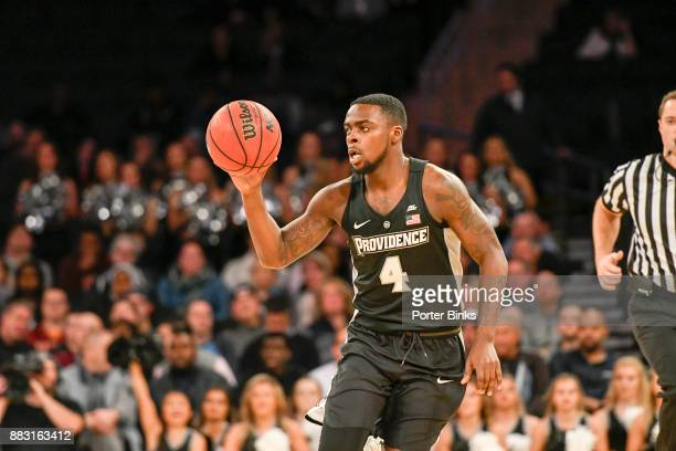 Maliek White of the Providence Friars passes against the Washington Huskies during the 2K Classic at Madison Square Garden on November 16 2017 in New...