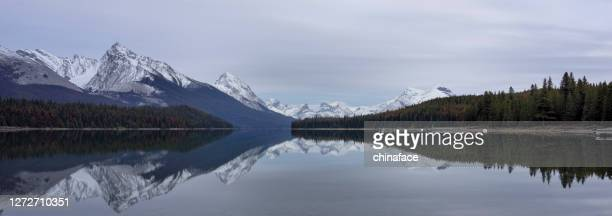 maligne lake in sunset - unesco world heritage site stock pictures, royalty-free photos & images