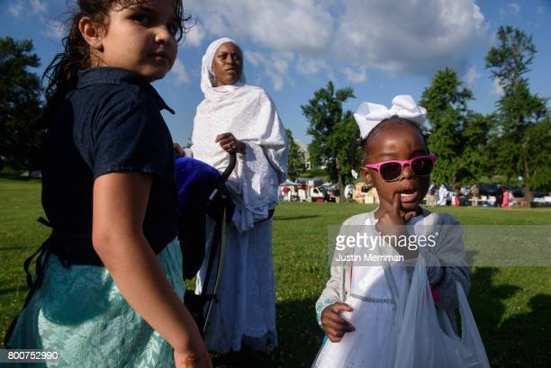 Maliha Reed of Swissvale Pa stands with family at an Eid alFitr celebration which marks the end of Ramadan on June 25 2017 in Pittsburgh Pennsylvania...