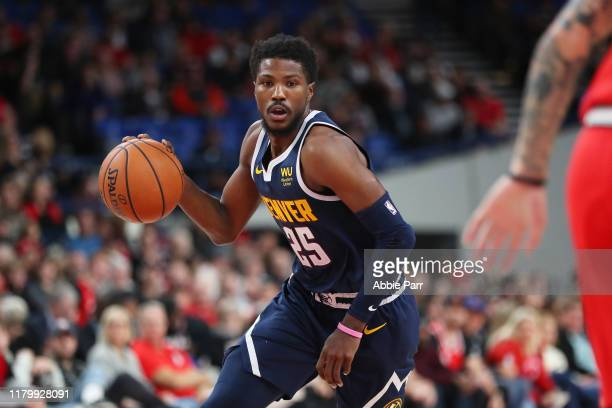 Malik Beasley of the Denver Nuggets dribbles with the ball in the fourth quarter against the Portland Trail Blazers during a preseason game at...