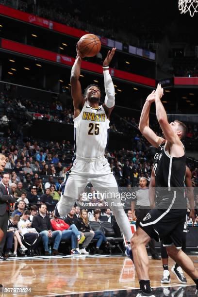 Malik Beasley of the Denver Nuggets drives to the basket against the Brooklyn Nets on October 29 2017 at Barclays Center in Brooklyn New York NOTE TO...