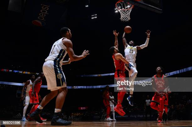 Malik Beasley of the Denver Nuggets drives to the basket against the Toronto Raptors on November 1 2017 at the Pepsi Center in Denver Colorado NOTE...