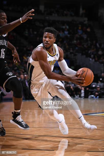 Malik Beasley of the Denver Nuggets drives to the basket against the Brooklyn Nets on November 7 2017 at the Pepsi Center in Denver Colorado NOTE TO...