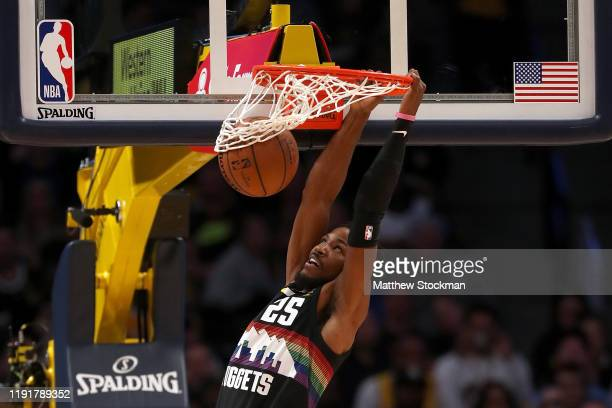 Malik Beasley of the Denver Nuggets dunks the ball against the Los Angeles Lakers in the second quarter at Pepsi Center on December 03 2019 in Denver...