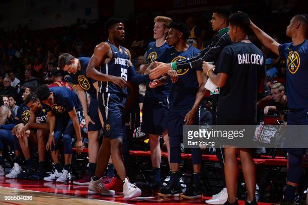 Malik Beasley of the Denver Nuggets exchanges high fives with his team against the Minnesota Timberwolves during the 2018 Las Vegas Summer League on...