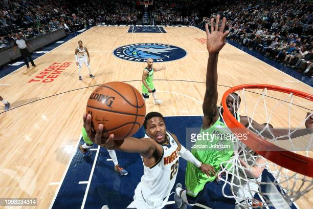 Malik Beasley of the Denver Nuggets goes to the basket against the Minnesota Timberwolves on February 2 2019 at Target Center in Minneapolis...