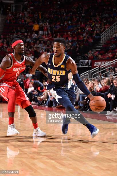 Malik Beasley of the Denver Nuggets handles the ball against Briante Weber of the Houston Rockets on November 22 2017 at the Toyota Center in Houston...