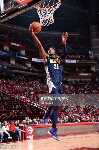 Malik Beasley of the Denver Nuggets shoots a lay up against the Houston Rockets on November 22 2017 at the Toyota Center in Houston Texas NOTE TO...