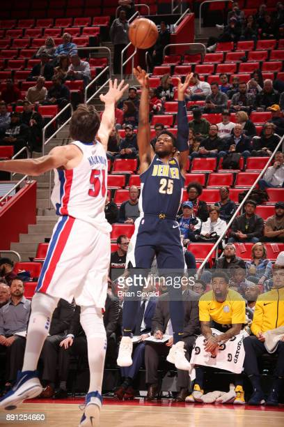 Malik Beasley of the Denver Nuggets shoots the ball against the Detroit Pistons on December 12 2017 at Little Caesars Arena in Detroit Michigan NOTE...