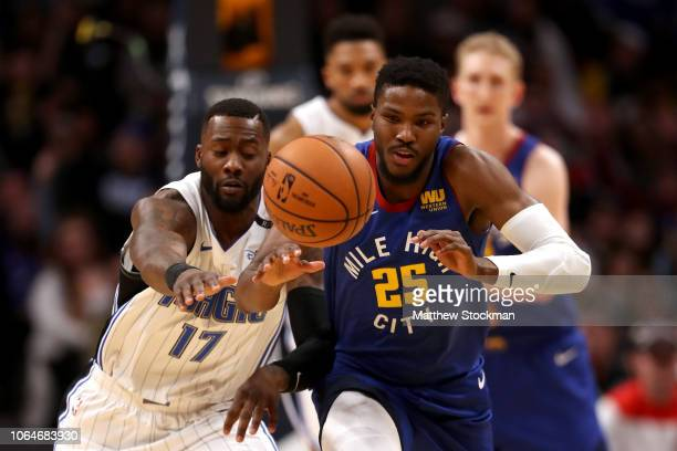 Malik Beasley of the Denver Nuggets steals the ball from Jonathon Simmons of the Orlando Magic at the Pepsi Center on November 23 2018 in Denver...