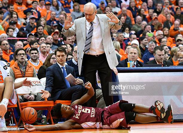 Malik Beasley of the Florida State Seminoles dives for a loose ball at the feet of head coach Jim Boeheim of the Syracuse Orange during the second...