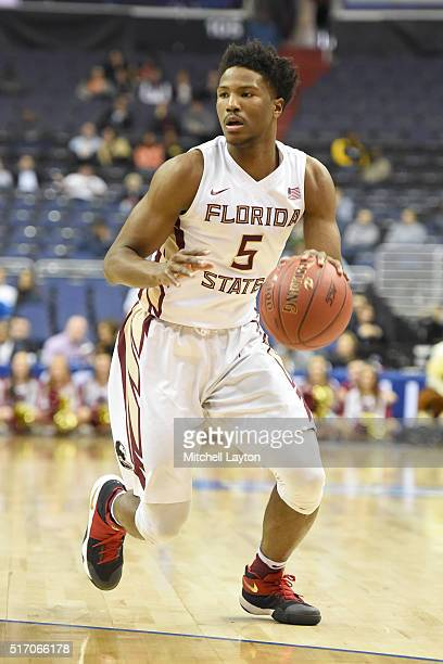 Malik Beasley of the Florida State Seminoles dribbles the ball during the first round game of the ACC Tournament against the Boston College Eagles at...