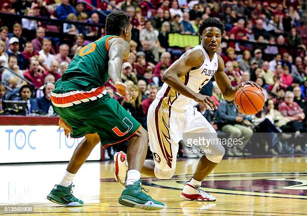 Malik Beasley of the Florida State Seminoles in action against Sheldon McClellan of the Miami Hurricanes during the game at the Donald L Tucker...