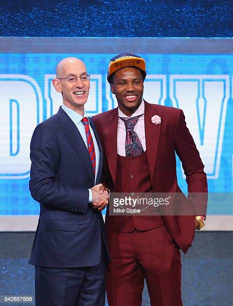 Malik Beasley poses with Commissioner Adam Silver after being drafted 19th overall by the Denver Nuggets in the first round of the 2016 NBA Draft at...