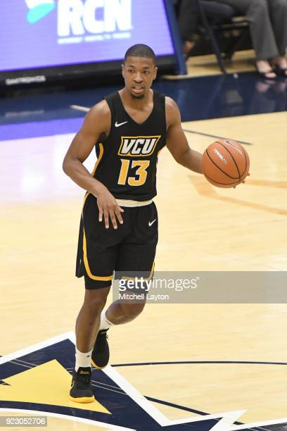 Malik Crowfield of the Virginia Commonwealth Rams dribbles up the ball during a college basketball game against the George Washington Colonials at...