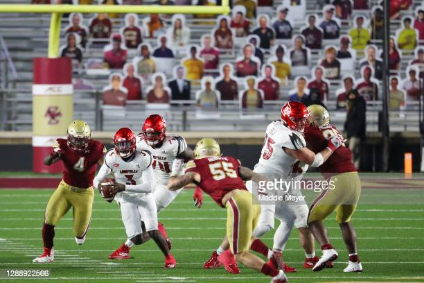Malik Cunningham of the Louisville Cardinals rushes the ball against the Boston College Eagles at Alumni Stadium on November 28, 2020 in Chestnut...