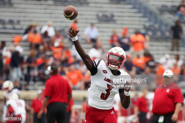 Zane Zandier of the Virginia Cavaliers celebrates a defensive stop in the first half during a game against the Louisville Cardinals at Scott Stadium...