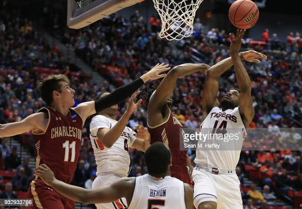 Malik Dunbar of the Auburn Tigers goes up for a shot against Jarrell Brantley and Evan Bailey of the Charleston Cougars in the first half in the...