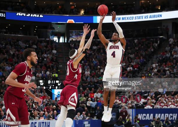 Malik Dunbar of the Auburn Tigers shoots the ball during the second half against the New Mexico State Aggies in the first round of the 2019 NCAA...