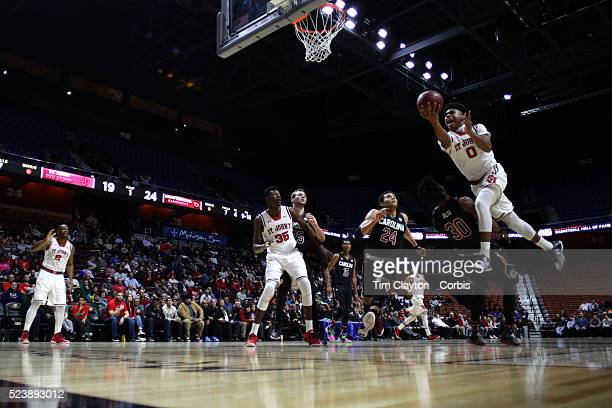 Malik Ellison St John's drives to the basket defended by Chris Silva South Carolina during the St John's vs South Carolina Men's College Basketball...