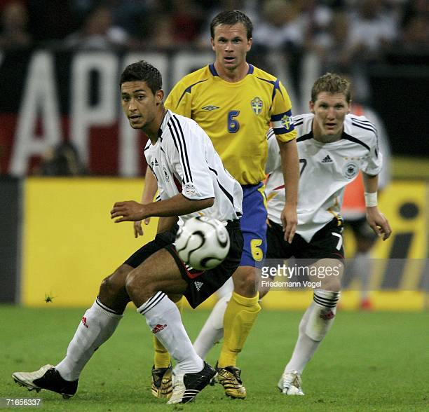 Malik Fathi and Bastian Schweinsteiger of Germany tussel for the ball with Tobias Linderoth of Sweden during the friendly match between Germany and...