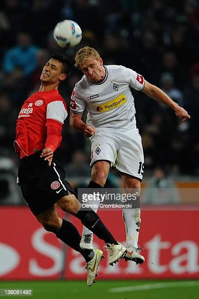 Malik Fathi of Mainz and Mike Hanke of Moenchengladbach jump for a header during the Bundesliga match between Borussia Moenchengladbach and FSV Mainz...