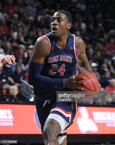 Malik Fitts of the Saint Mary's Gaels brings the ball up the court against the Gonzaga Bulldogs during the championship game of the West Coast...