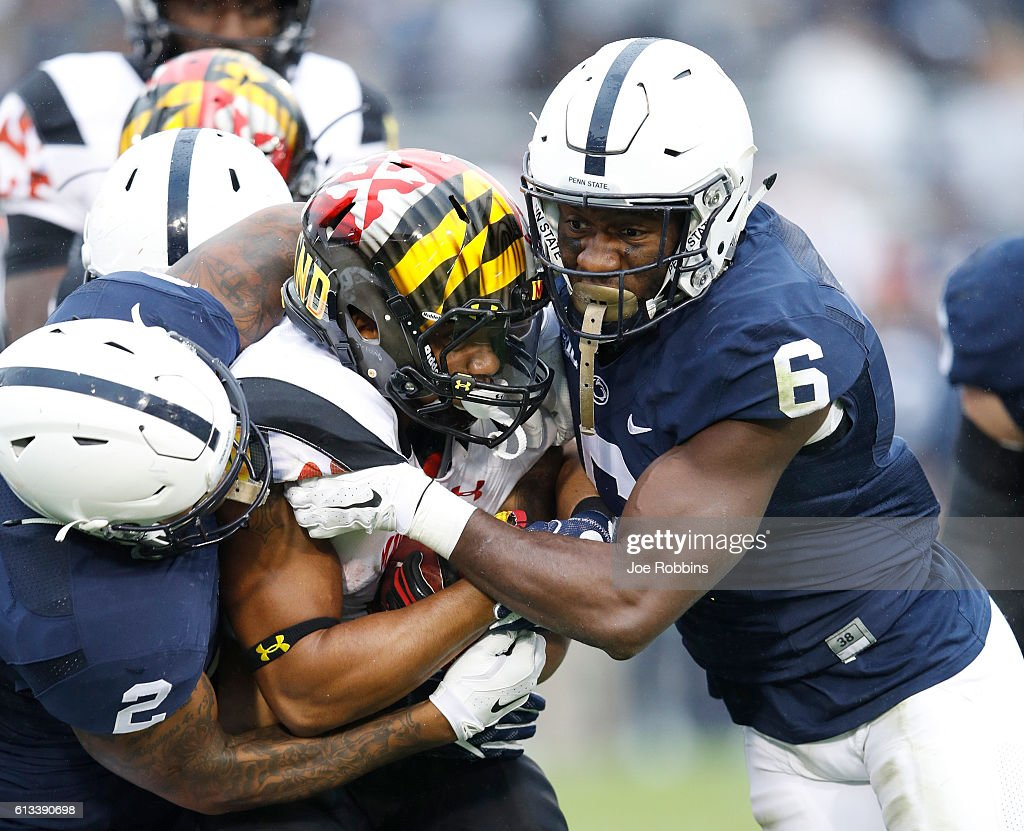Malik Golden #6 and Marcus Allen #2 of the Penn State Nittany Lions make a tackle against the Maryland Terrapins in the second half at Beaver Stadium on October 8, 2016 in State College, Pennsylvania. Penn State defeated Maryland 38-14.