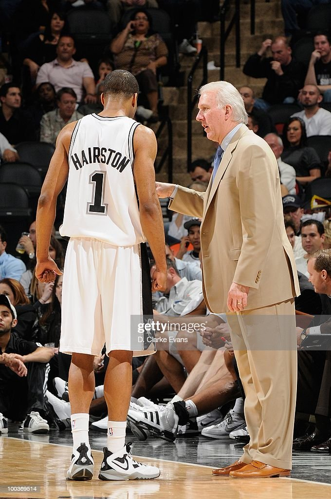 Malik Hairston #1 and head coach Gregg Popovich of the San Antonio Spurs talk during the game against the Los Angeles Clippers on March 13, 2010 at the AT&T Center in San Antonio, Texas. The Spurs won 118-88.