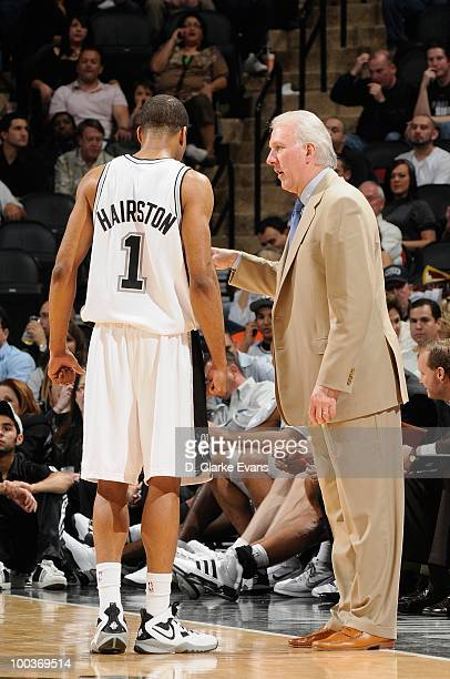 Malik Hairston and head coach Gregg Popovich of the San Antonio Spurs talk during the game against the Los Angeles Clippers on March 13 2010 at the...