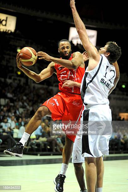 Malik Hairston of EA7 competes with Angelo Gigli of SAIE3 during the Lega Basket Serie A match between SAIE3 Bologna and EA7 Emporio Armani Milano at...
