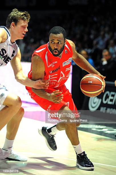 Malik Hairston of EA7 competes with Viktor Gaddefors of SAIE3 during the Lega Basket Serie A match between SAIE3 Bologna and EA7 Emporio Armani...