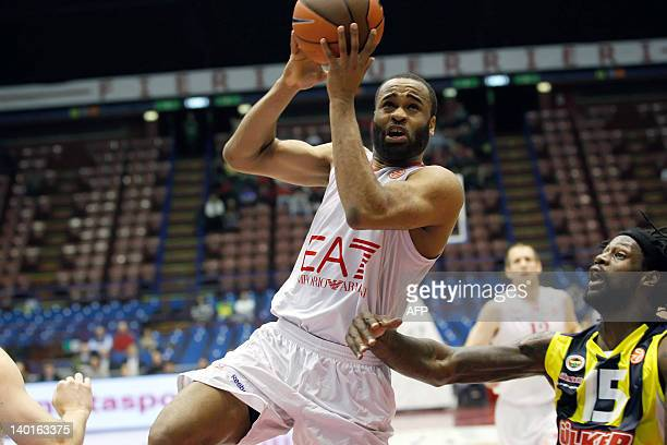 Malik Hairston of EA7 Emporio Armani Milan shoots contested by James Gist of Fenerbahce Ulker during 20112012 Turkish Airlines Euroleague TOP 16 Game...