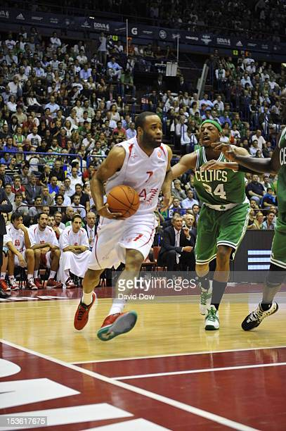 Malik Hairston of the EA7 Emporio Armani Milano drives the ball against Paul Pierce of the Boston Celtics during the game between the Boston Celtics...