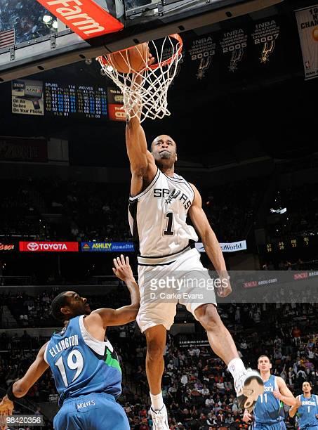Malik Hairston of the San Antonio Spurs dunks over Wayne Ellington of the Minnesota Timberwolves on April 12 2010 at the ATT Center in San Antonio...