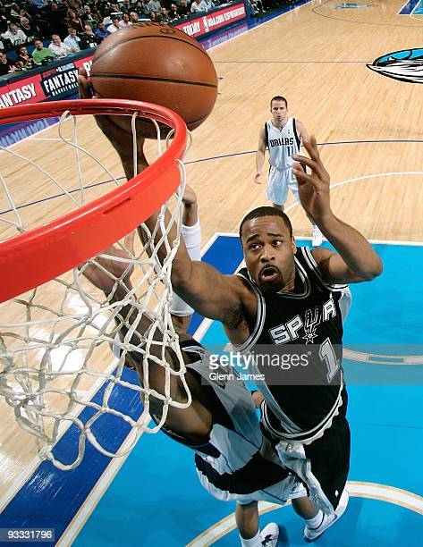 Malik Hairston of the San Antonio Spurs lays up a shot against Drew Gooden of the Dallas Mavericks during the game on November 18 2009 at American...