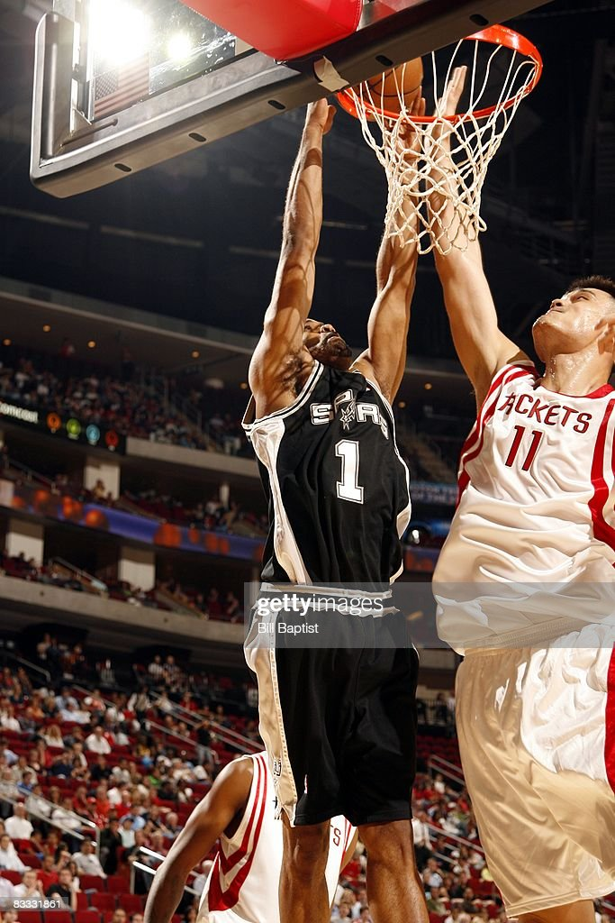 Malik Hairston #1 of the San Antonio Spurs talkes the ball to the basket against Yao Ming #11 of the Houston Rockets during the game at the Toyota Center on October 9, 2008 in Houston, Texas. The Rockets won 85-78.