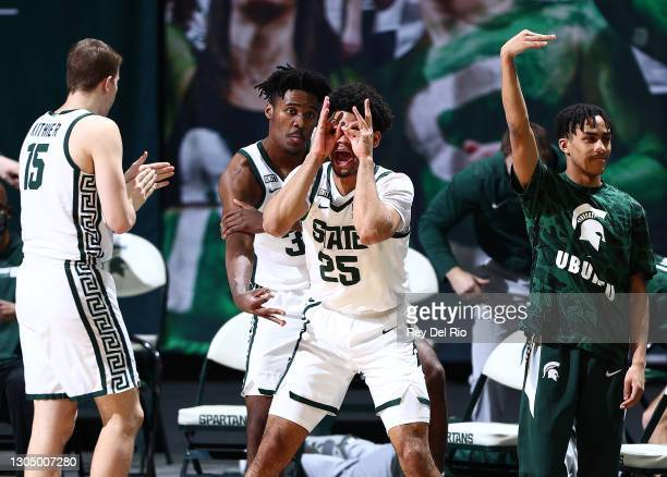Malik Hall and Julius Marble II of the Michigan State Spartans celebrate from the bench in the second half of the game against the Indiana Hoosiers...