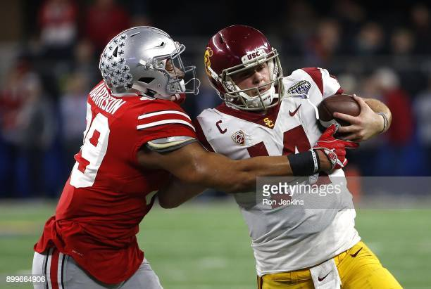 Malik Harrison of the Ohio State Buckeyes runs Sam Darnold of the USC Trojans out of bounds in the second half of the 82nd Goodyear Cotton Bowl...