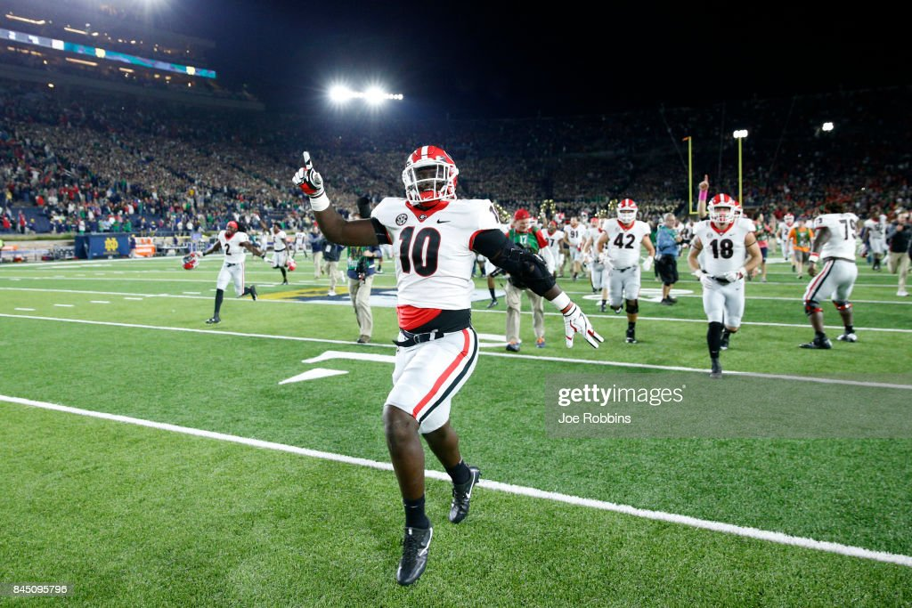 Malik Herring #10 of the Georgia Bulldogs celebrates after a 20-19 win against the Notre Dame Fighting Irish at Notre Dame Stadium on September 9, 2017 in South Bend, Indiana.