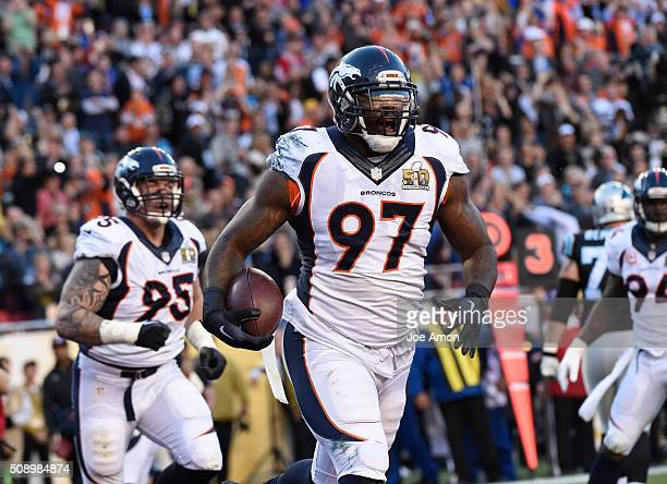 Malik Jackson of the Denver Broncos celebrates his touchdown after recovering a fumble in the first quarter The Denver Broncos played the Carolina...
